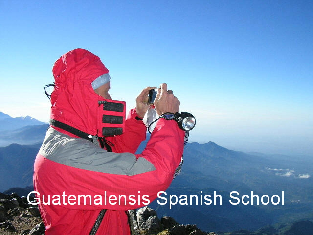 Foreign student enjoying the view from the summit of a guatemalan volcano.